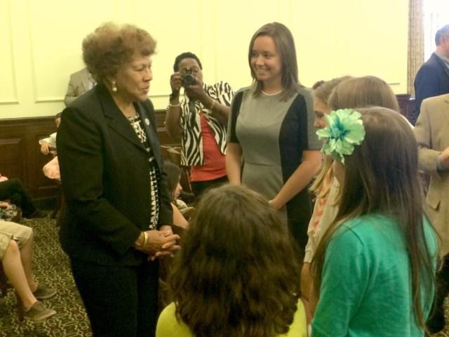 senator turner with students and teacher