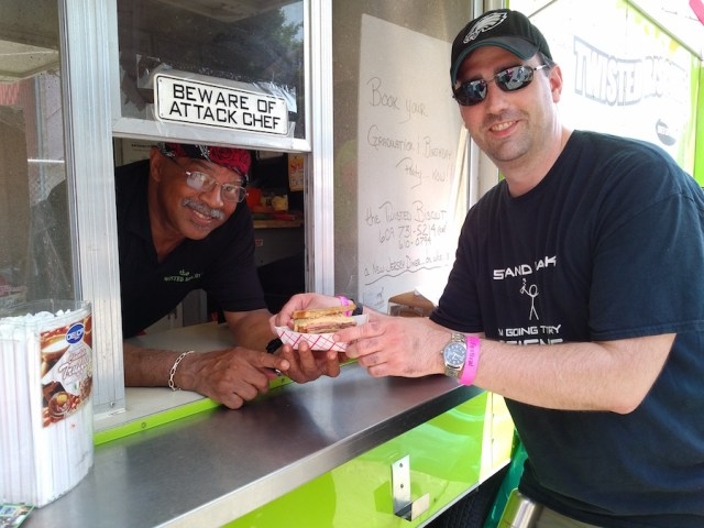 Chef Buddy handing over a Pork Roll Rueben