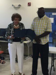 Senator Shirley Turner presents the resolution to Arzaga Dillard