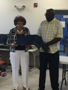 Senator Shirley Turner presents the resolution to Arzaga Dillard