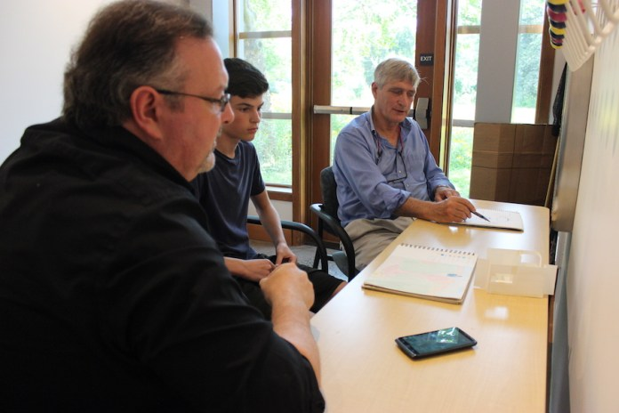 Sophomore David Rawley meets with Architects Jason Kliwinski and Michael Farewell