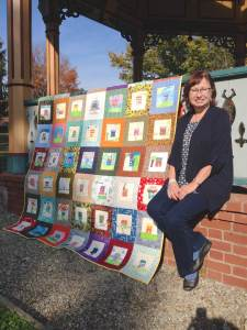 Cindy Friedman with Hopewell's 125th anniversary children's quilt