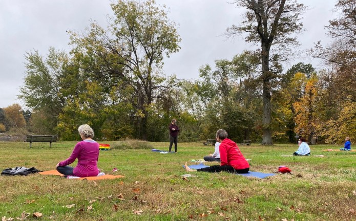 Socially distant yoga available on the River