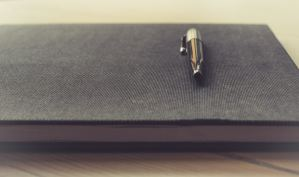 Image of book with pen