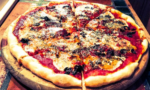 Pizza with fresh mozzarella and oil cured black olives