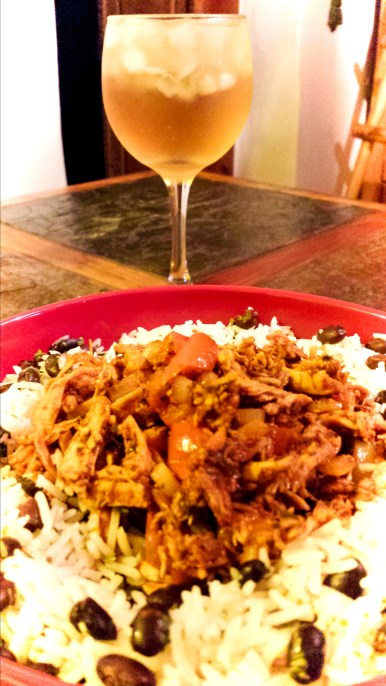 Pollo en Adobo, served with Black Beans and Rice and accompanied by White Sangria