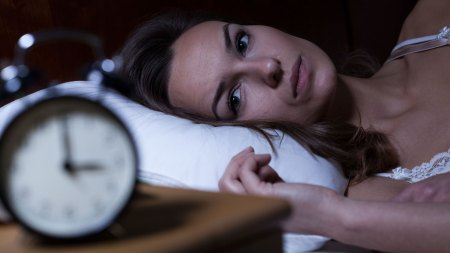 Woman in bed struggling with insomnia
