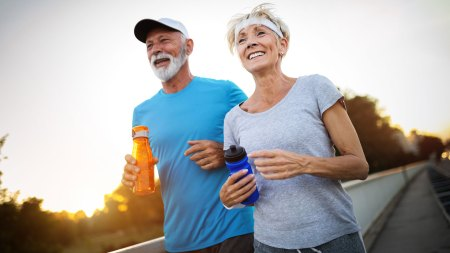 Older couple running outside feature image