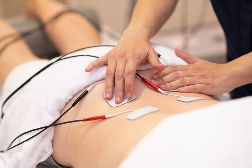 electric stimulation therapy on the back