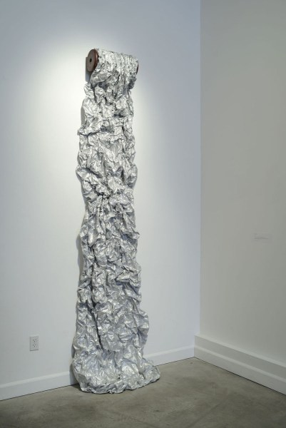 Spill (2014), Stitched Tyvek, 108 x 30 X 12 inches