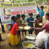 Nirmala supplying food for the children