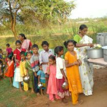 Nirmala Feeding The Children.