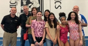 From letf to right: Bryan, Andy Barta, Lori Barta, their daughter, Kathy, her daughter, and two other gymnasts with their coach.
