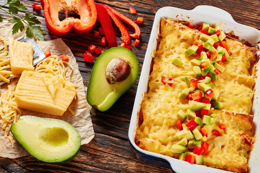 baked enchiladas of rolled corn tortillas