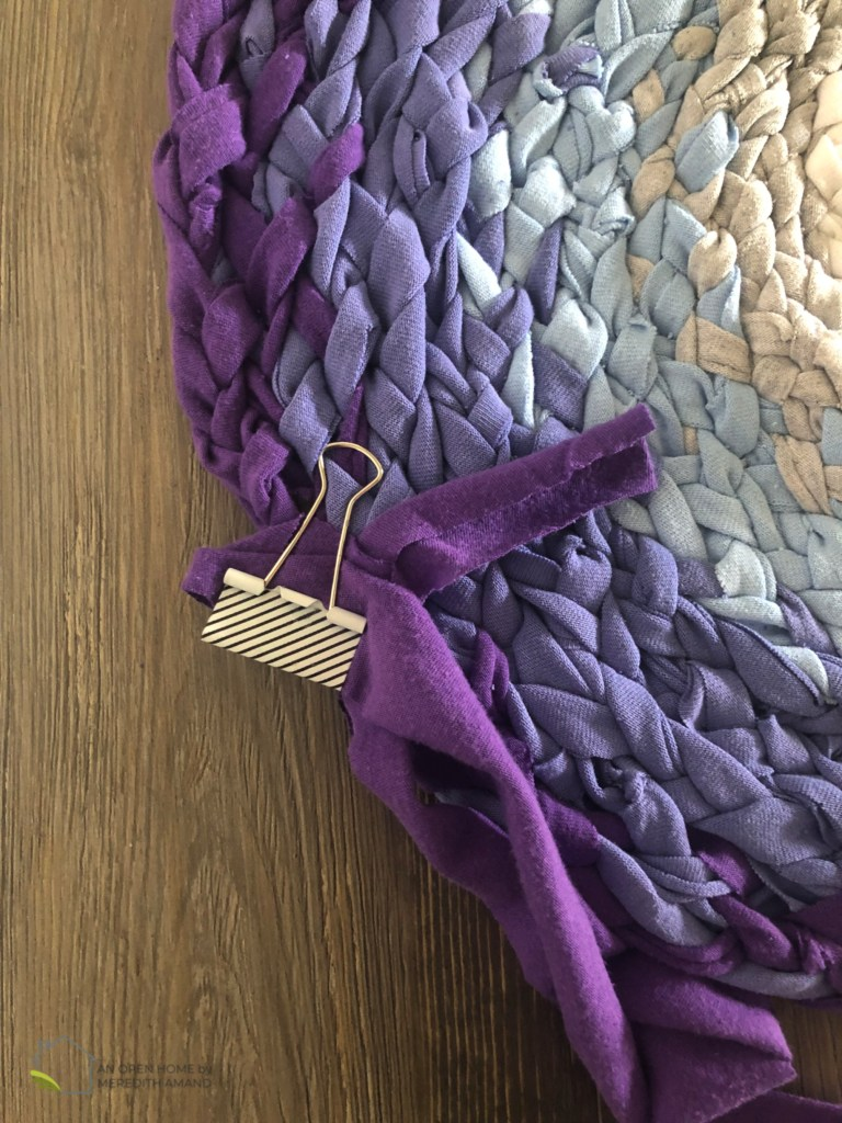 Recycled Rag Rug Made from Old T-Shirts - How to make a beautiful and functional braided rug with strips of old shirts | MeredithAmand.com