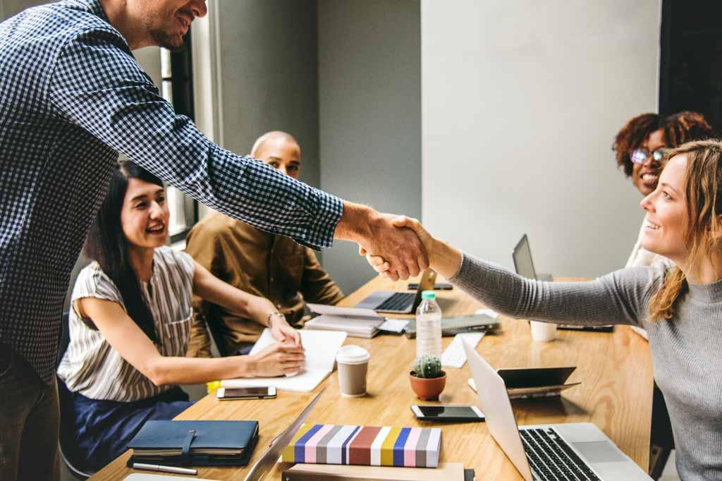 Photo - Hand shake in meeting