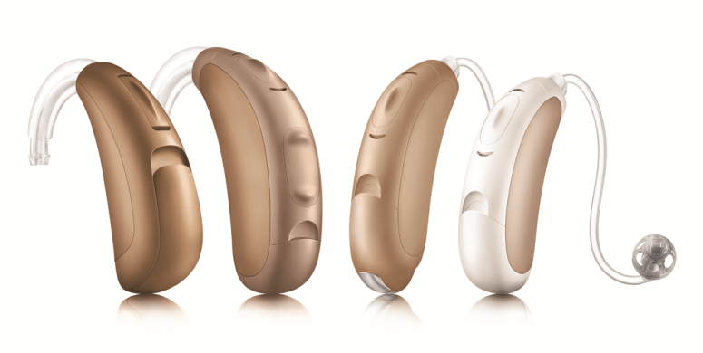 4 single behind-the-ear (BTE) hearing aids in shades of brown and tan