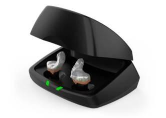 Starkey Livio Edge AI custom rechargeable hearing aids inside black charging case
