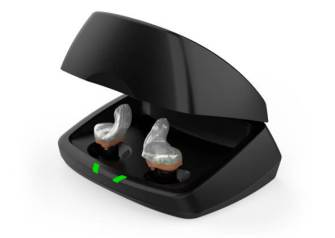 Pair of silver Starkey custom rechargeable hearing aids inside black charging case