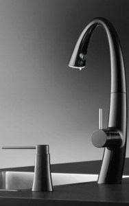 silver faucet with dark background