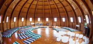dome wood room with mats in circle on the floor
