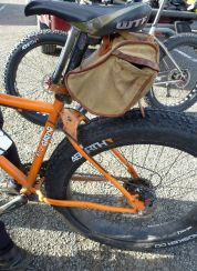 """This was damn cool. Not the saddle bag (but that's cool too). A Surly rear triangle replacement for 4"""" tires. Did it himself with whatever steel scrap he could find."""