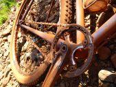 Red dirt sticks to the bike