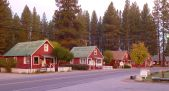 Long line of red mill-worker cabins along the main drag in Graegle.