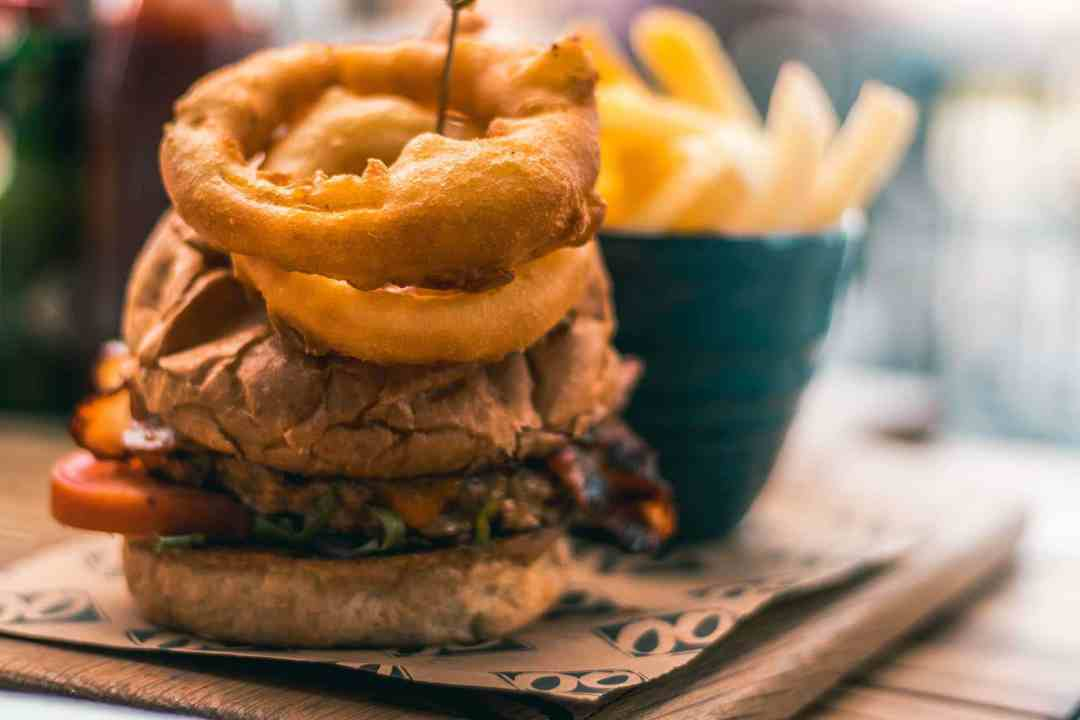 Red hot blue burger with onion rings