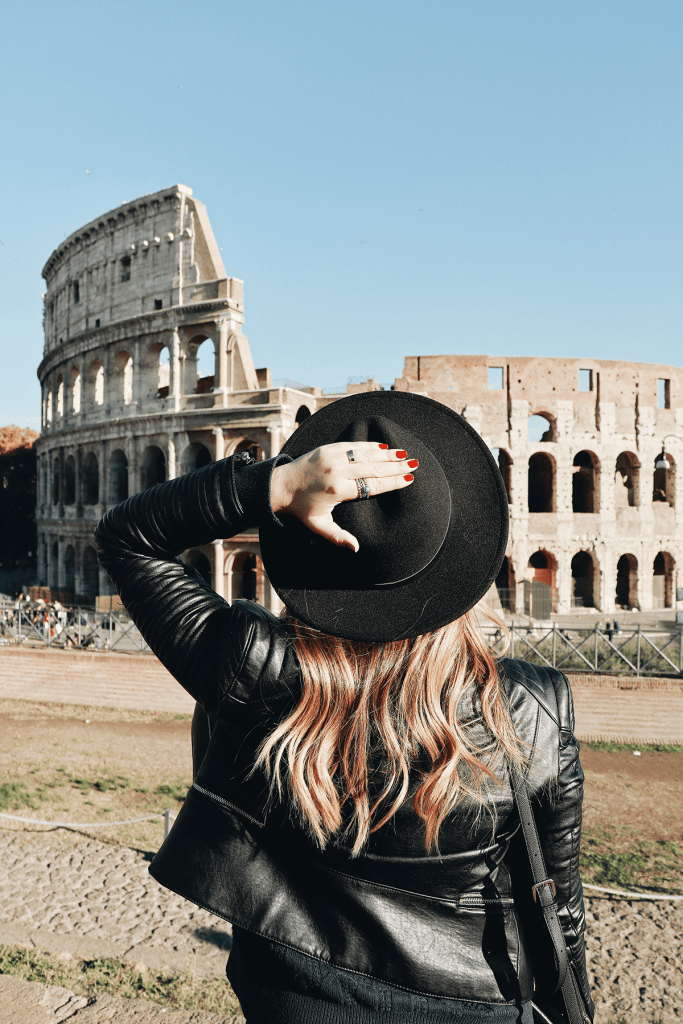 Colosseum Rome Italy and a Women in a leather Jacket