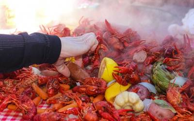Easy crawfish boil served traditionally on a checkered tablecloth