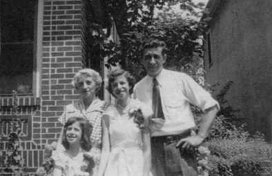 Merrill, age thirteen, with her sister Barbara, her mother and father, 1951