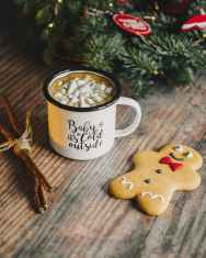 gingerbread man near coffee mug