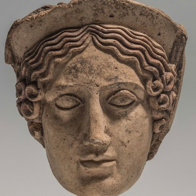 head of a maiden demeter or kore/persephone