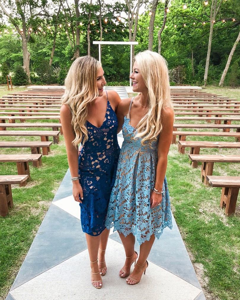 sisters looking at each other in lace blue dresses. wedding guests  best seller in may