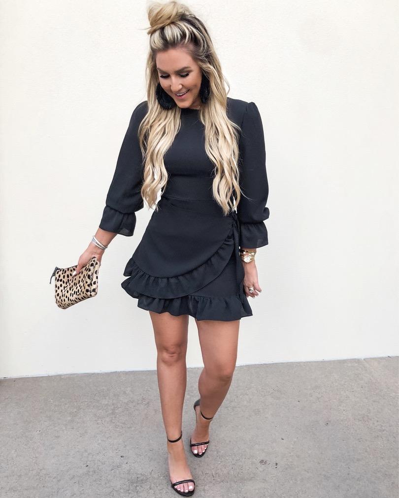 girl in black ruffle dress going to dinner