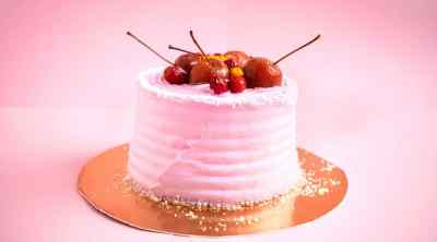 small-round-pink-birthday-cake-with-mastic-decor-fruits