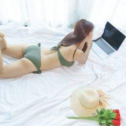 sexy-asian-woman-bikini-green-working-laptop-bed