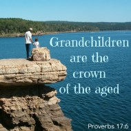 Scripture--Proverbs 17:6 written on photo of grandfather and child overlooking a lake
