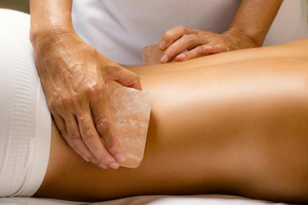 himalayan salt massage close up shutterstock