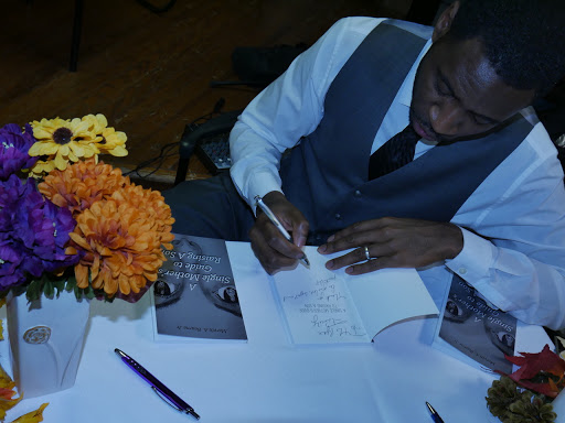 mb signing 2 with flowers