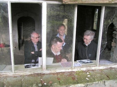 Tate conservator Derek Pullen with Prof. Steve Hoskins and Paul Thirkell of the University of the West of England, and artist John Baldwin, assessing the condition of the Merz Barn, April 27th, 2007