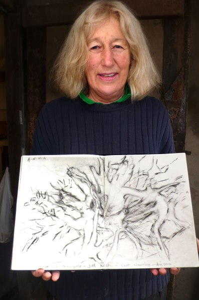 Artist Jill Rock with drawing of the Willow Root.