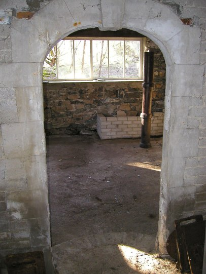 Inside the Merz Barn, looking from the Cake Room. (the drain pipes happened to be there, and were set up to show approximately where Schwitters had planned to erect a pillar sculpture).