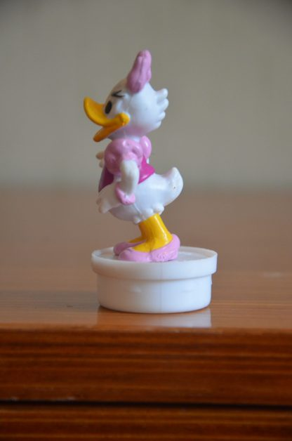 Bouchon de tube de smarties Nestlé, figurine de Daisy en plastique. Made in China