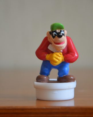 Bouchon de tube de bonbons Smarties Nestlé, figurine d'un des Rapetou en plastique, 7cm de haut et 3 cm de large. Made in China.