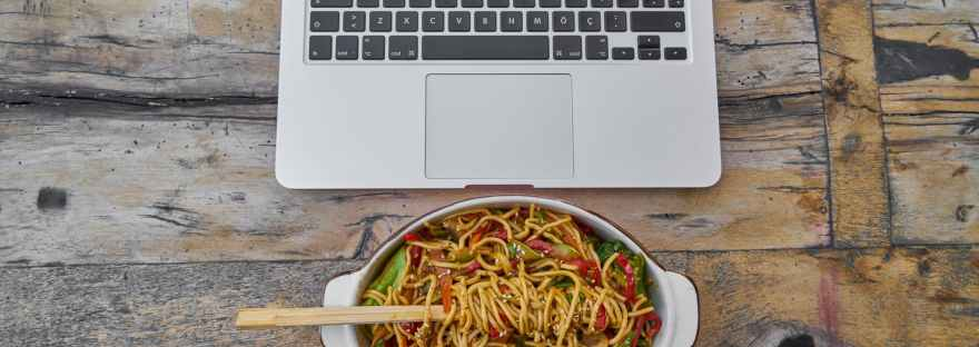 macbook pro beside pasta