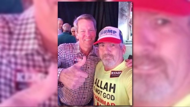 Governor Kemp poses with Gregory McMichael? False.