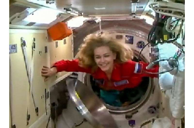 Russian crew arrives at space station to film first movie in orbit  / phys. org/