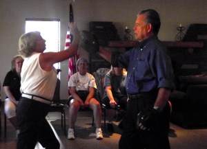 Peggy Pope and John Hughes demonstrate an upper strike using the palm of the hand.  A strike such as this can be effective to use toward the chin or the nose of an attacker.